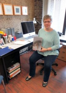 Sue Colberg In Her Creative Studio With The Award Winning Book The Body In Question(s).
