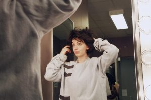 Jodie Mcrobbie (tape Mouth Person In The Abbedam Production Orestes 2.0.) Adjusts Her Wig In The Dressing Room.